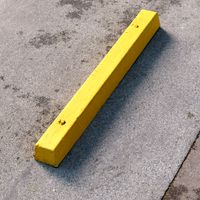 Yellow concrete parking stopper #02