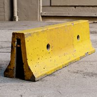 Yellow weathered concrete parking block