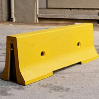 Yellow concrete parking block