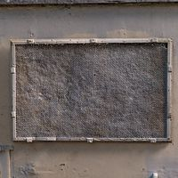 Old, painted fine-mesh screened window