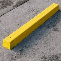Yellow concrete parking stopper #01